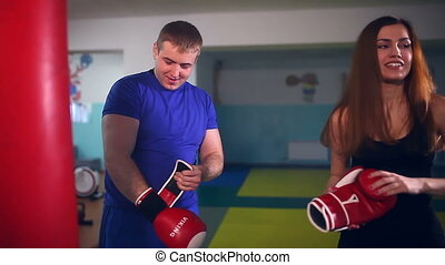 man boxer coach teaches sport girl boxing at gym