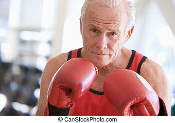 Man Boxing At Gym