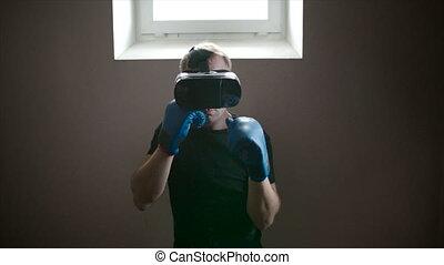 Man boxing in VR glasses