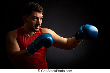 man boxing on black background