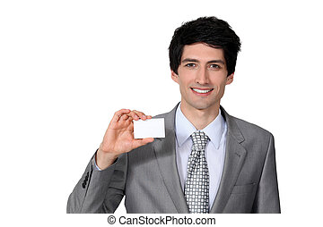 Man brandishing business card