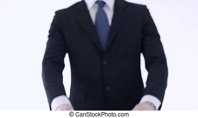 man breaking a contract - man in suit and tie breaking a...