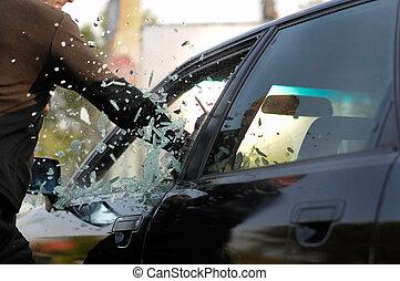 man  breaking car window - one man breaking car window