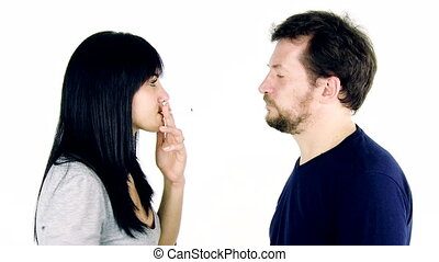 Man breaking cigarette to woman