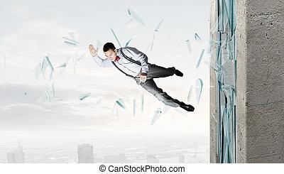 Man breaking through glass