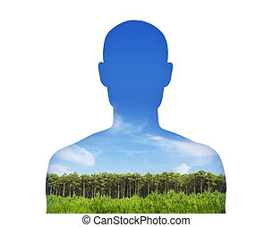 man breathing clean air - silhouette of a young man's ...