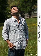 Man breathing in fresh air
