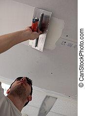 man, brengend, een, plasterboard, plafond