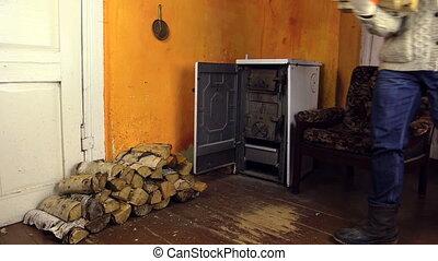 man bring wood axe room