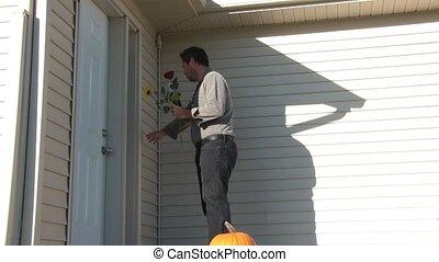 Man Brings Flowers to Door for Date - Man brings flowers and...