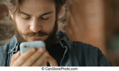 Man Browses the Internet - Concentrated caucasian man...