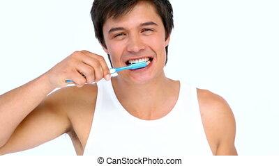 Man brushing and looking his teeth