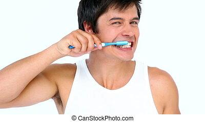 Man brushing his teeth against white background