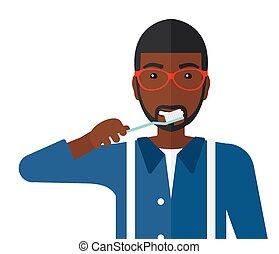 Man brushing teeth. - An african-american man brushing his...