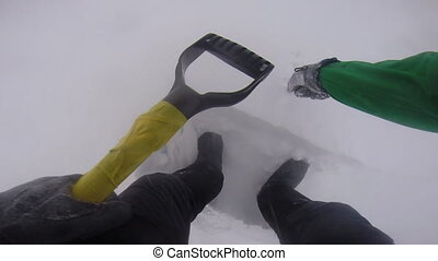 Man building an igloo