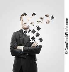 man built of puzzle - businessman built of puzzle on white...