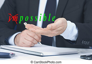 man business hand with the concept of impossible