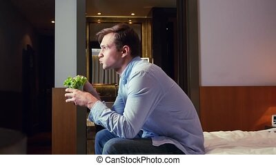 man businessman eats Vegetarian eating cabbage leaves in a...