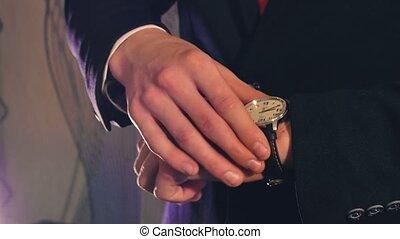 man businessman in suit jacket looks clock - man businessman...