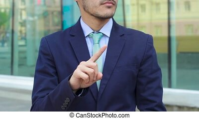Man businessman show gesture No with his hand and finger