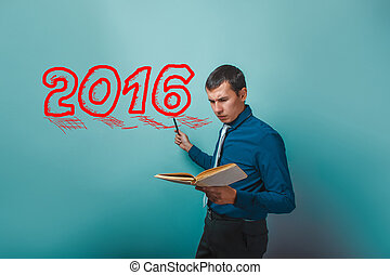 man businessman with a book professor points to the year 2016