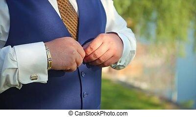 Man Buttoning Waistcoat Preparing to Wedding Groom natural...