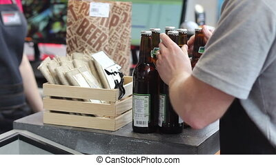 man buy beer at store