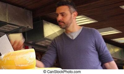 Man buy cheese - Shot of Man buy cheese
