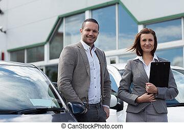 Man buying a new car
