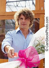 man buying flowers