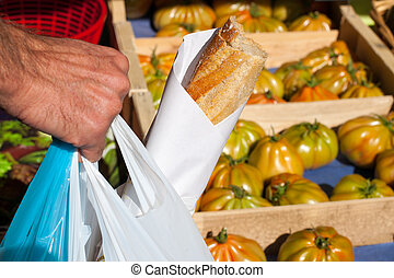 Man buying food on local market - Man buying food on a local...