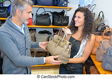 Man buying purse