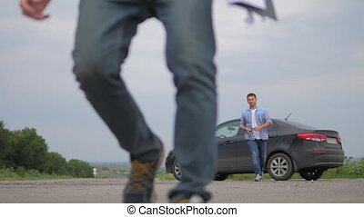 man buys a used car. two men make a deal. man seller driver...