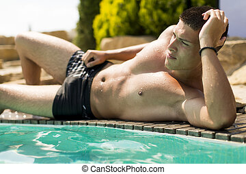 Man by the pool