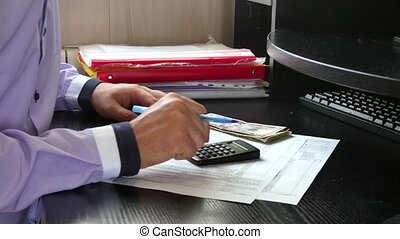 Man calculate his profit in business