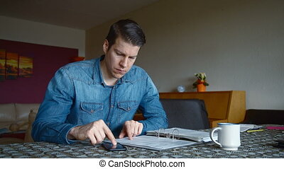 Man calculating Bills in Living Room
