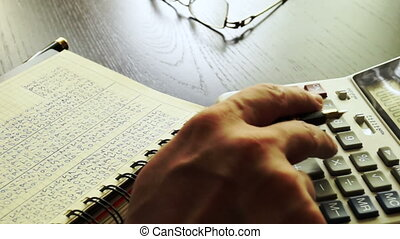 Man calculating financial figures. Accounting and audit...