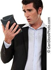 Man calculating his budget