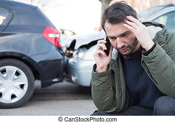 Man calling first aid after car crash accident