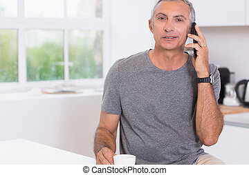 Man calling someone in the kitchen