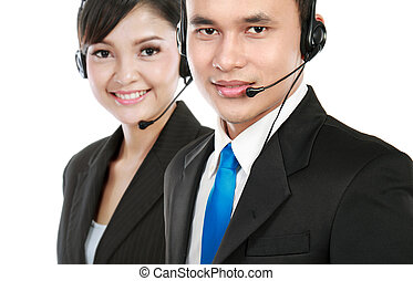 man calling - Closeup of call center employee smiling with...