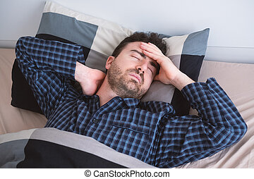 Man can't sleep in bed suffering insomnia