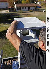 Man capping a chimney stack