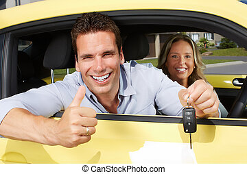 Man car driver with key. - Happy young man driver in a new...