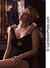 Man caressing woman gently