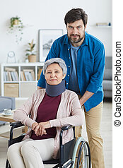 Man caring about disabled woman