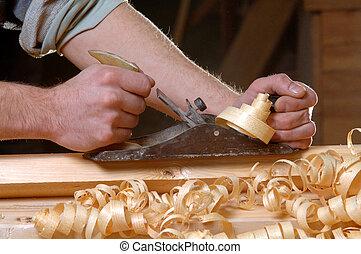 man carpenter handles board planers