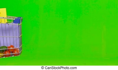 Man carries a cart with food. Green screen. Close up