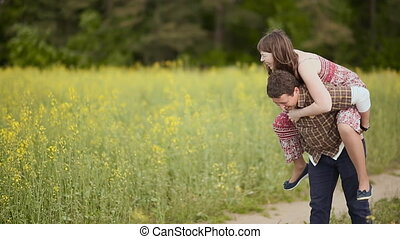 Man carries a girl on his back