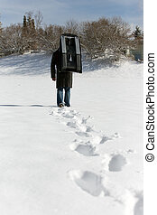 man carry a sledge in the deep snow, footprints in the front
